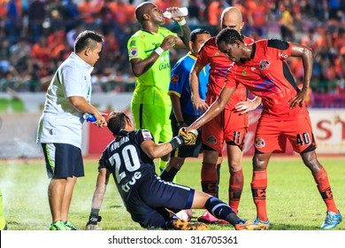 SISAKET THAILAND-SEPTEMBER 12: Adefolarin Durosinmi of Sisaket FC. (orange) show good sportsmanship during Thai Premier League match at Sri Nakhon Lamduan Stadium on September 12,2015,Thailand