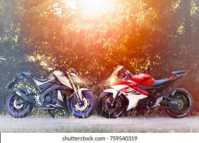 SISAKET,THAILAND - NOVEMBER 18 2017 :  Yamaha M-SLAZ VS Yamaha YZF R15 on concrete road, Yamaha M-SLAZ Dark Edition 2017, Yamaha YZF R15 2014