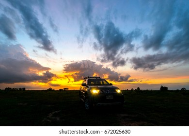 Sisaket,Thailand,05 JULY 2017;Headlights car with sunset,Sisaket province,Thailand.