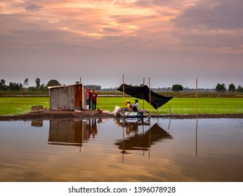 Sisaket,Thailand,11 May 2019;Public toilet in the field rice reflection in water,Sisaket province,Thailand,ASIA.