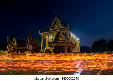 Sisaket,Thailand,18 May 2019; Candle lights from people walk around Amazing Temple Wat Sri Bueng Bun in Srisaket at twilight time, Sisaket province  province,Thailand,ASIA.