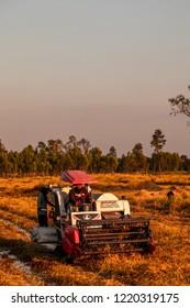 SISAKET,THAILAND,Dec 3, 2018:  The harvesters Kubota working on the field in the evening  ,at sisaket thailand.