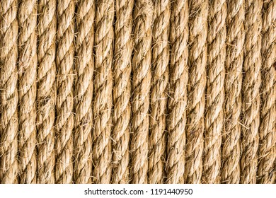 Sisal rope background, natural fibre twist rope, biodegradable verticaly aligned, landscape orientation.