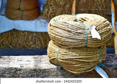 Sisal Rope roll, Manila rope rolled in a circle stacked on an outdoor wooden table