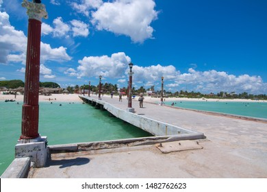 SISAL, YUCATAN/ MEXICO - JULY 30, 2019: Sisal is a charming port town on the Yucatan Peninsula and is the perfect escape for tourists looking for a relaxed getaway with beautiful beaches.