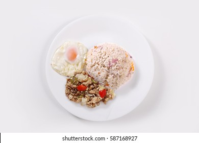 Sisilog Filipino Street Food. A combination of Sisig dish, Sunny SIde up Egg and Fried Rice know as sinangang in The Philippines. Flat Lay Shot.