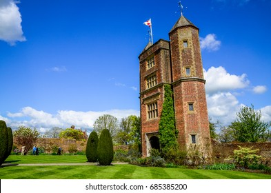 SISSINGHURST CASTLE, KENT, ENGLAND - JULY 18, 2017: The Elizabethan tower at Sissinghurst in summer, one of the most famous gardens in England. It is now owned and maintained by the National Trust