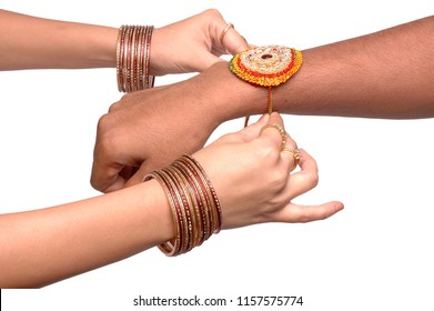 A sister is binding rakhi on her brother s hand on the occasion of raksha Bandhan