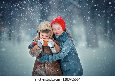 Sister and brother are eating warm bread on frost in Russia in winter. Image with selective focus and toning