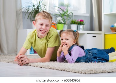 Sister and brother playing together in a room