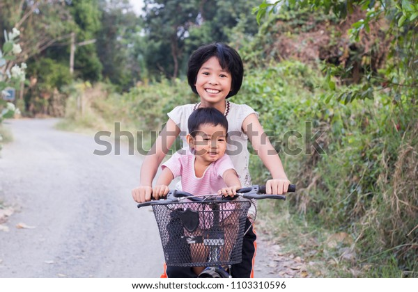 Sister and brother Ride the bike at the park