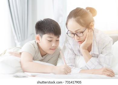 Sister helping brother to doing homework