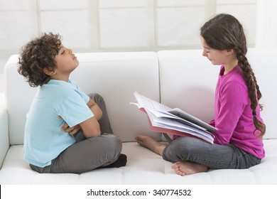 Sister helping brother to learn lesson