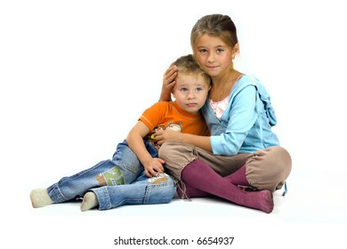 Sister helps her young brother solving problems isolated on white