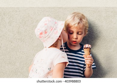 Sister kissed brother who eats ice cream