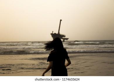 Sister Looks to an old broken ship . Eljadida/MOROCCO : by Rady Jocker
