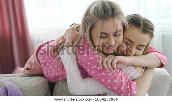 sister love. best friends hugging. trust closeness. girls bff friendship. family bonds