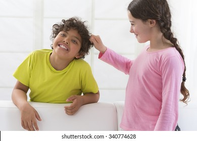 sister pulling brothers hair