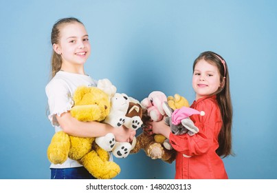 Sisters best friends play. Sweet childhood. Childhood concept. Softness and tenderness. Charity sale. Love and friendship. Kids adorable cute girls play soft toys. Happy childhood. Child care.