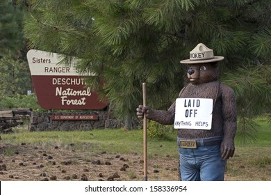 SISTERS, OR - OCTOBER 13: Smokey The Bear outside of US Forest Service office in Sisters, Oregon  with Laid Off sign during government shutdown October 13, 2013.