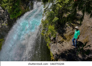 Sisters, Oregon - 7/20/2019: A man hiking on the McKenzier River trail at a viewpoint next to  Sahale Falls, near McKenzie River, Oregon
