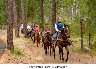 Sisters, Oregon - 7/30/2008: A young woman leading a trail ride at Black Butte Ranch near Sisters, Oregon