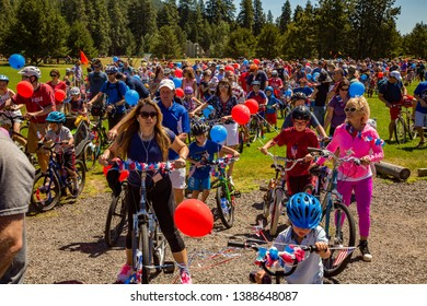 Sisters, Oregon - 7/4/2016:  Children and adults just starting a ride in a 4th of july parade at Blask Butte Ranch resort near Sister