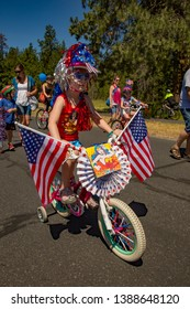 Sisters, Oregon - 7/4/2016:  A young girl riding her decorarted bike in a 4th of July parade at Black Butte Ranch resort near Sisters