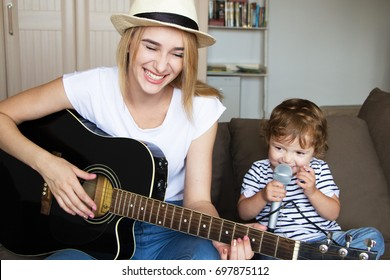 Sisters playing the guitar and singing