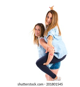 Sisters playing over white background