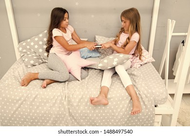 Sisters relations issues. Children in bedroom want read evening fairy tale. This is my book. Girlish rivalry. She dont want to share her book. Sisters rivalry concept. Share book with friend.