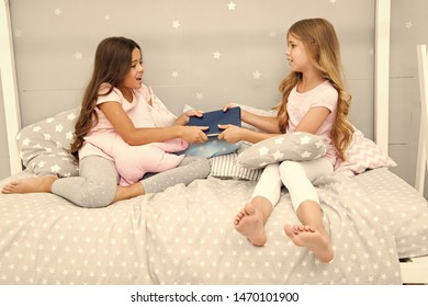 Sisters rivalry concept. Sisters relations issues. Share book with friend. Children in bedroom want read evening fairy tale. This is my book. Girlish rivalry. She dont want to share her book.