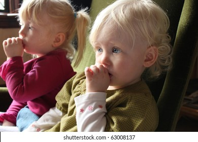 sisters watching television together