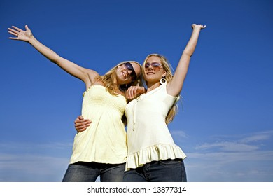 sisters wearing yellow top and jeans in the summer