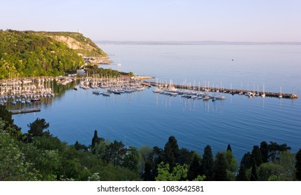 Sistiana bay near Trieste, Italy, and its marina just before a springtime sunset