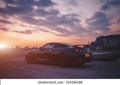 SISTIANA, ITALY JUNE 12, 2013: Photo of a Nissan GT-R Black Edition side view at the sunset. The Nissan GT-R is a 2-door 2+2 sports car produced by Nissan and unveiled in 2007.