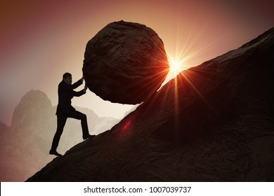 Sisyphus metaphore. Silhouette of businessman pushing heavy stone boulder up on hill.