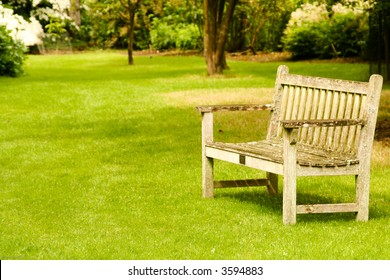 Sit down and relax! Garden bench in a tranquil garden