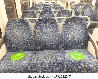 Sit Here sign use in Sydney train service to stop spread of Coronavirus.