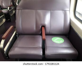 Sit here sign use in train service in Sydney, Australia to fight Coronavirus.