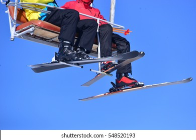 sit on the ski lift and waiving hand with sky