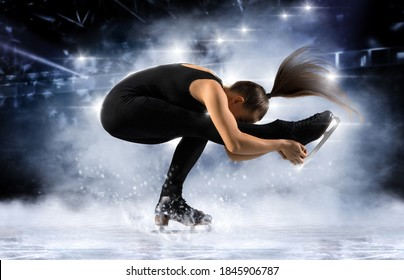 Sit spin. Woman figure skating in action on dark background. Sports banner. Horizontal copy space background