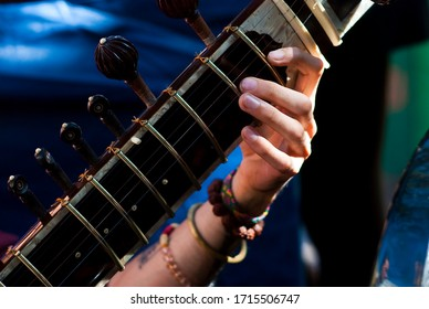 Sitar being played by musician, close up.