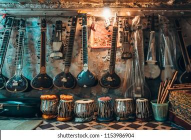 The sitar shop at Varanasi street. Traditional indian music. Indian music salon. Varanasi backstreet.