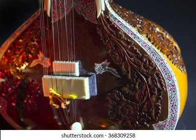 Sitar, a String Traditional Indian Musical Instrument, close-up, blue lens effect. dark background, soft focus. Evening of ethnic oriental music. Indian Raga