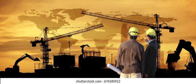 site manager and project manager on site,two civil engineer working in building construction site against beautiful dusky sky with crane construction