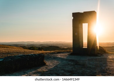 Site Transitoire at sunset, in the middle of crop fields. Siena, Tuscany. Ancient building 1993 inspired to Stonehenge
