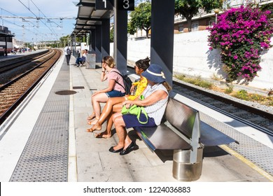Sitges, Spain - 2nd October 2017: People waiting for the train on Sitges station. Thr railway connects with Barcelona.
