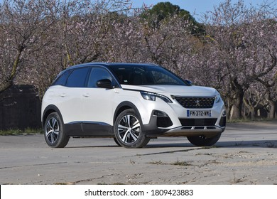 Sitges, Spain - 6th February, 2020: Hybrid plug-in vehicle Peugeot 3008 HYbrid4 stopped on a road.