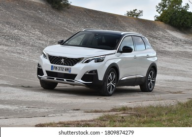 Sitges, Spain - 6th February, 2020: Hybrid plug-in vehicle Peugeot 3008 HYbrid4 stopped on the old road.